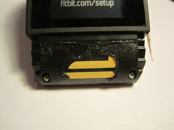 Once you remove the bands scrape away the glue on the top side to expose the GPS antenna
