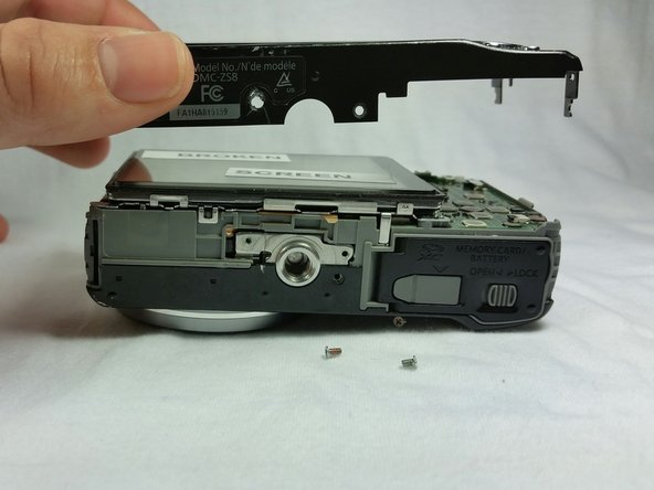 Remove two screws from the bottom of the back panel and remove the back panel as shown in the picture.