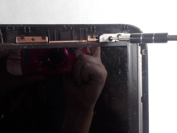 Once all the screws are removed, gently remove the screen from the outer casing.