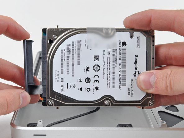 Image 2/2: Remove the hard drive cable by pulling its connector straight away from the hard drive.