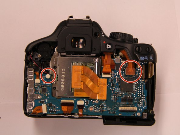 Image 1/1: Remove the microphone connection on the upper left hand side of the circuit board.