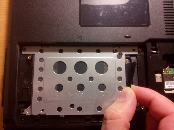 pull the strap to remove the hard drive's case