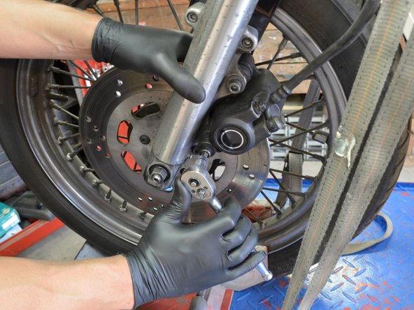 Using a torque wrench, tighten both screws to between 25 and 30 inch-pounds.