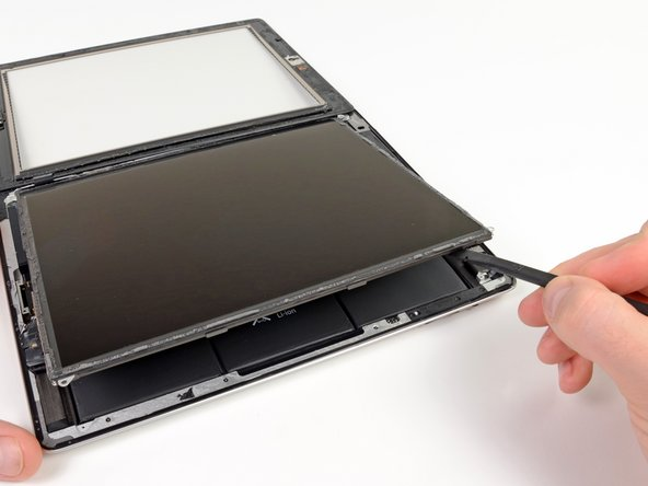Image 1/3: Using a plastic opening tool or a spudger, lift the right edge of the LCD out of the iPad.