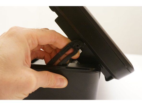 Gently pull on the hook. Retain the scanner glass and the cover once the hook is removed.
