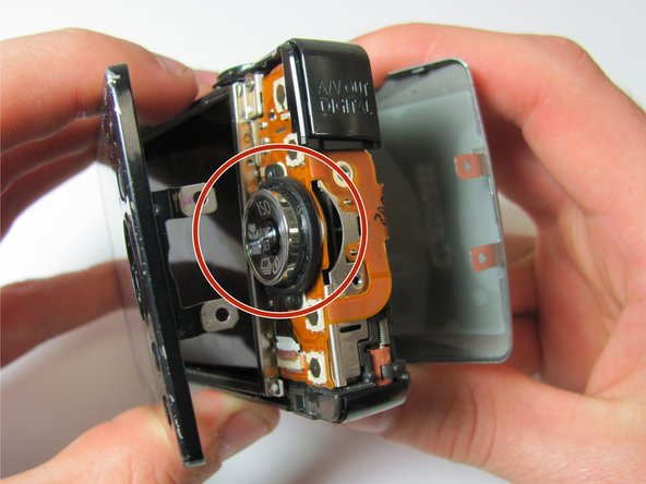 Place the camera on the side opposite of the wrist strap handle.