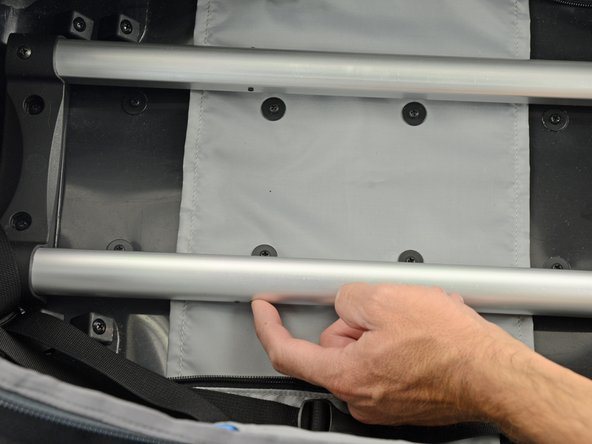If either pin is not retracting when the button on the handle is depressed, push the pin into the hole using your finger or another thin object such as a pencil or screwdriver.