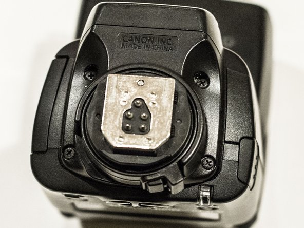 Image 2/3: Remove mounting cap on the side of the flash