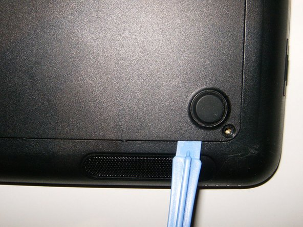 Use a plastic opening tool to unsnap the cover from the back case.