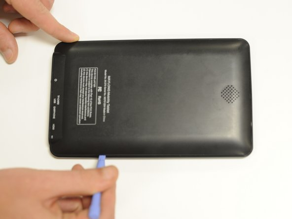 Use the plastic opening tool to separate the back cover plate from the front.