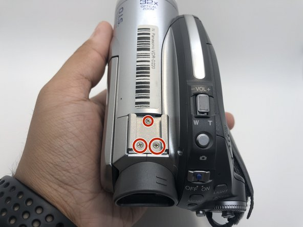 Remove all three 5mm screws from the top of the camera using a Phillips #0 screwdriver.