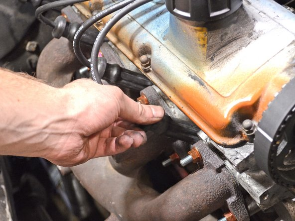 Before placing the boot back on the spark plug, spread a layer of dielectric grease on the opening of the boot. This will keep moisture and corrosion away from the spark plug, as well as make the boot easier to remove in the future.
