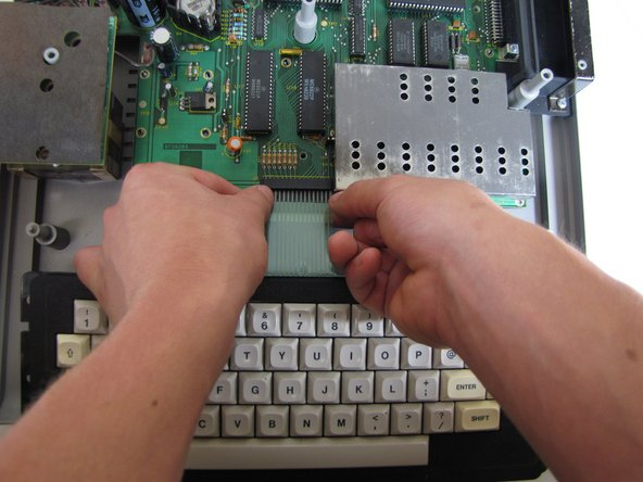 Near the motherboard, gently pull the keyboard ribbon cable until it becomes free.