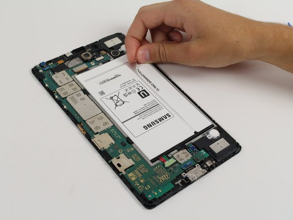 Image 1/2: Be careful when lifting the battery out, it is still connected to the device.