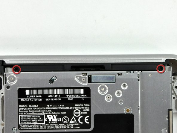 Remove the three 2.5 mm Phillips screws securing the optical drive to the upper case.