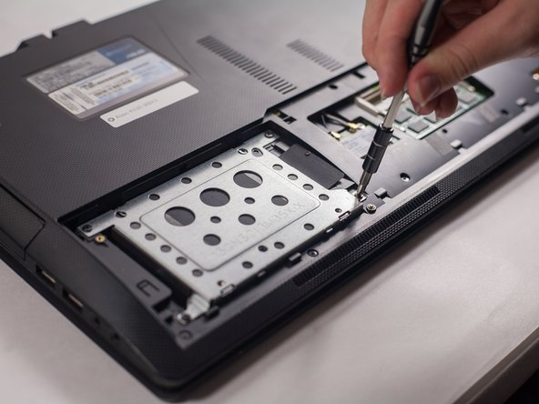 Image 2/3: Lift the hard drive out of the computer.