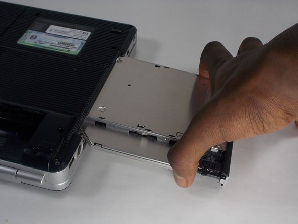When reassembling, slide the optical drive straight in until it clicks.