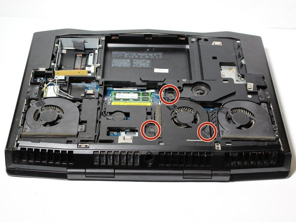 There are three internal fans within the laptop. Locate the correct screws to loosen for the desired fan to replace based on the provided corresponding images.