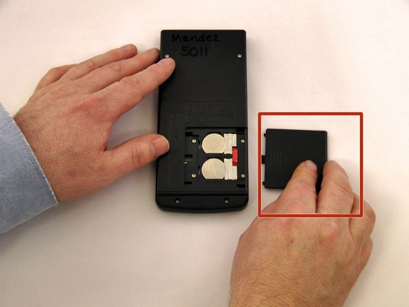Slide the battery cover to the right to reveal the batteries.