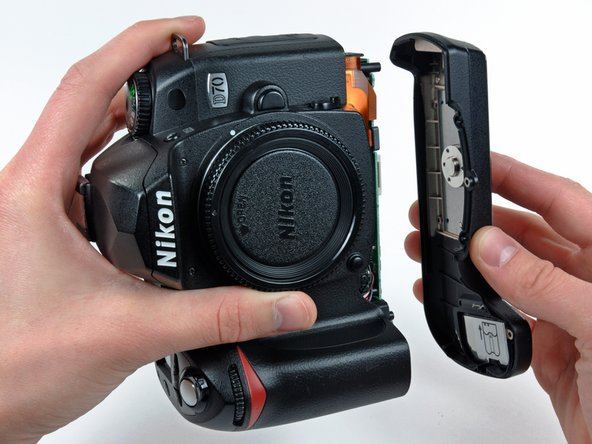 Image 2/2: Remove the bottom cover from the D70.