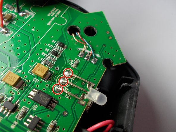 Image 2/2: Removing three prongs, one at a time, heat the shiny solder point for first prong.