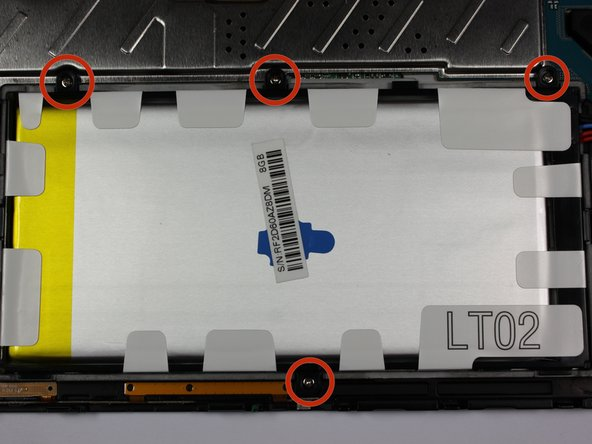 To begin actual removal of the battery itself, remove the four designated screws with your screwdriver.