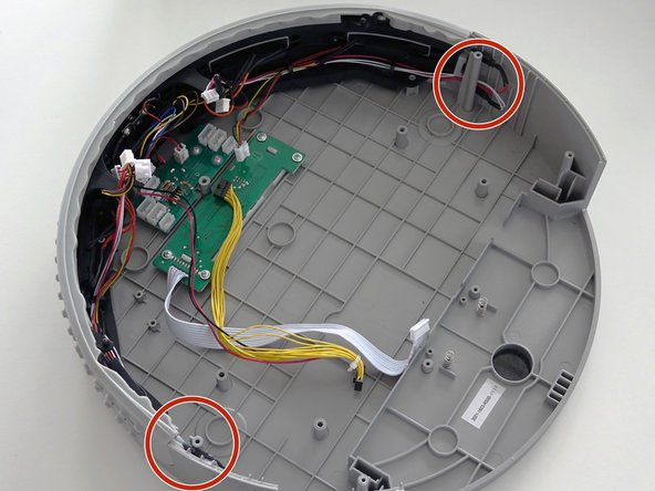 On the left and right sides of the bumper are bObi Pet's sensor strips. They connect to the circuit board by red and white wires.