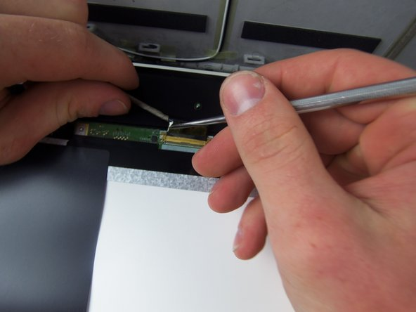 Remove the cord from the screen by cutting the tape where the two fittings meet. After that pull them apart.