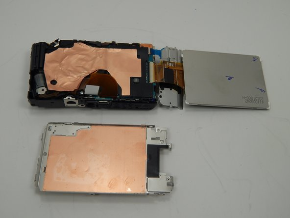 Remove the metal plate that was underneath the LCD screen from the camera.