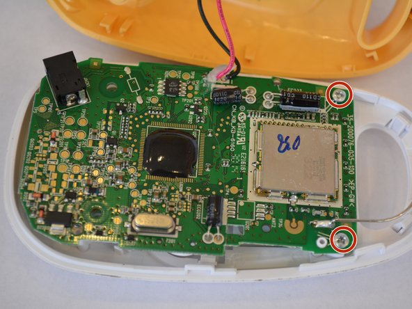 Image 1/2: Flip over the motherboard and  de-solder the wires connecting the speaker to the motherboard