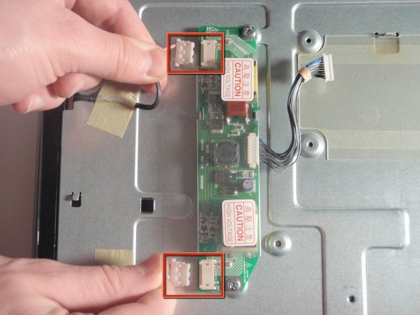 Locate the top and bottom connector on the CCFL inverter and remove it by inserting pin into the small holes and pulling away.