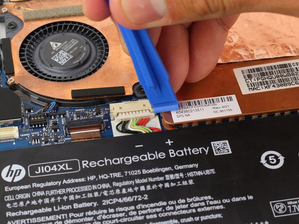 Remove the battery's connector by pushing both sides of the tab towards yourself  with a plastic opening tool.