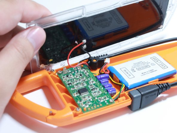 Caution: the solar cell is attached to the top cover and connected to the circuit board by a short wire.