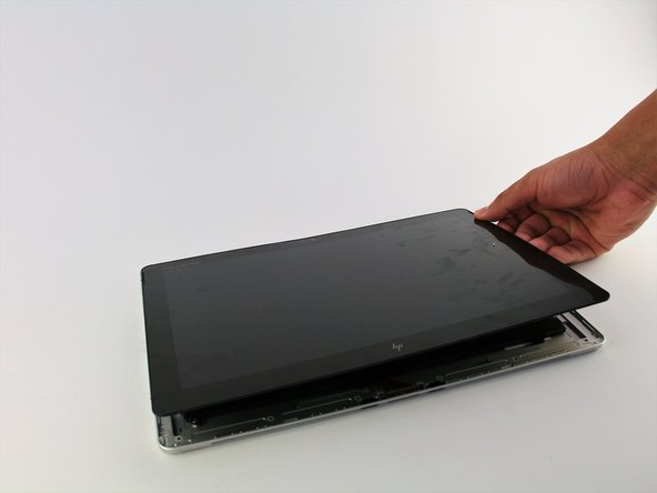 Remove the screen by gently lifting it off of the device.