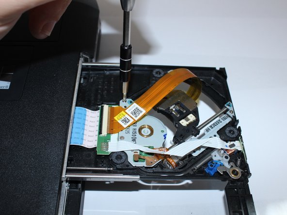 Remove 3 screws of disc drive with the J0 Phillips-head screwdriver.