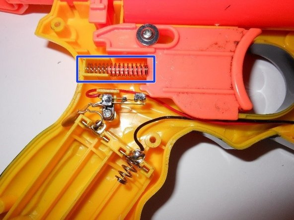Remove the trigger by pulling the piece straight up.