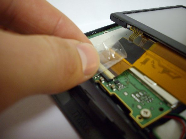 Lift the touch screen above the mother board so that its position is similar to what is shown.