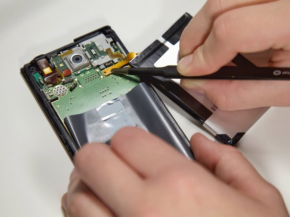 Use the tweezers to remove the Pancake connector that connects the battery to the phone.