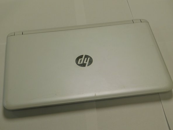 Flip the Laptop to the back side.  Making the battery facing up.