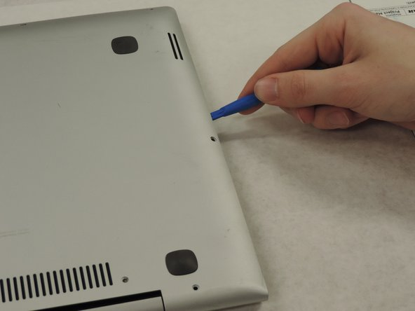 Use a pry tool or iFixIt Opening tool to separate the back panel from the device.