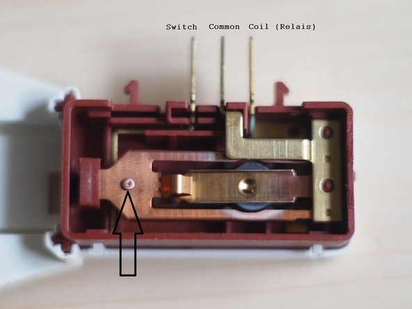 The arrow points the contact of the switch. My machine stopped working because the door switch did not work properly. The machine never detected a closed door and hence never started wasching.