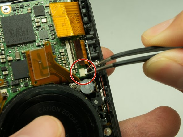 Unplug the small chip from the face of the camera using a pair of tweezers.