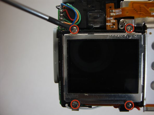 Remove the four 4.40mm screws that hold the LCD screen in place to the frame.