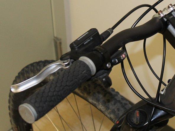 Slide the handlebar grips back onto the ends of the handlebars.