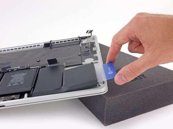 Lift the battery cell to separate it from the MacBook Pro's upper case, but don't try to remove it.