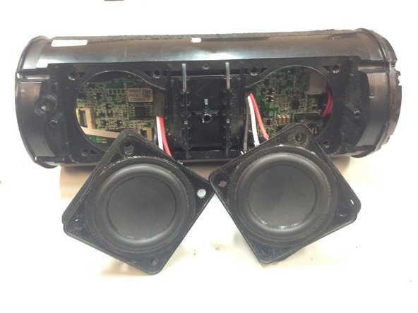 Using a pry tool, remove speakers from housing as seen in the picture.