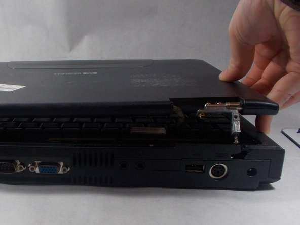 Lift the entire top away from the bottom, and set bottom half of the laptop aside.