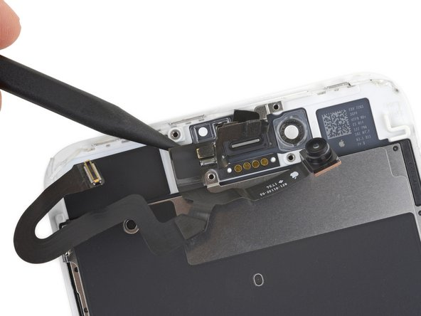Insert the point of a spudger underneath the same portion of the flex cable that you separated in the previous step.
