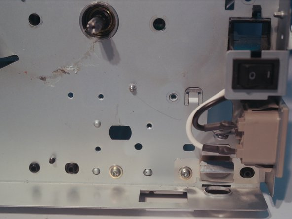 Image 3/3: Remove one screw on the printer chassis.