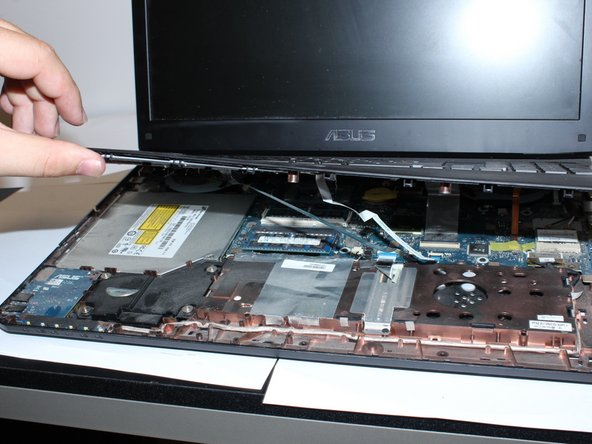 You will need to lift the keypad platform with your hands to get to the laptop's internal systems.